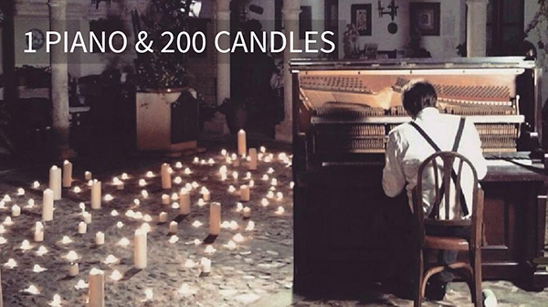 Man Playing Piano around Candles